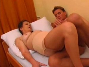 Hairy Granny in stockings fucked by young man. Hairy Granny in stockings fucked by young man