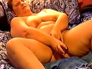 Amateur SSBBW wife in bed using a huge sex tool for her cunt, My amateur wife is just a huge chunk of white fat. SSBBW wife in bed can please herself only with a huge sex tool. She can barely reach her cunt because of all that fat on her belly.
