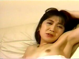 Shy Asian Brunette Gets Fucked. Petite brunette Asian Emiko sits on the couch and makes out with her horny boyfriend. He pulls down her top to expose her pert natural tits, and she spreads her legs so he can play with her pussy through her panties. He lies down and she slides down his body to suck his hard cock, and he lays her back to fuck her missionary. She gets on her hands and knees and he gets behind her to give it to her doggy style, and he thrusts his dick in and out of her tight snatch before he finally blows his load deep in her pussy.