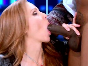 Brazzers Exxtra: Two Bangz vs Nancy. Julia Ann, Isiah Maxwell. Nancy (Julia Ann) is a right-wing talk show host who's been on a moral crusade against big dicks for months now, and world-famous hip-hop mogul 2 Bangz (Isiah Maxwell) is on her show to defend big-dicked gentlemen everywhere. After trying to hold a calm and rational debate, he gets sick of Nancy's interruptions and whips it out right on live television! Entranced by the power of the big black cock, Nancy wraps her pretty lips around that fat dick, letting 2 Bangz fuck her big titties, her throat, and of course her wet MILF pussy. Now that's great TV!