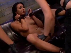 Isa Mendez Takes More Double Penetration Fun from Brooklyn Daniels & Lexy Villa. The submissive and obedient sex slave Isa Mendez has been begging us to end up in the dungeon again. She seems addicted to lesbian domination, threesomes if possible. She loves being slapped and spanked, gagged and fucked roughly, deep and hard down her throat and pussy. We definitely have everything Isa wants. Brooklyn Daniels and Lexy Villa heard about her desires and took it upon themselves to bring their kinky Latina hottie over. They place a tight leather collar around her neck, cuffs on her wrists, linking them to the collar. They brought out the sofa this time, sitting Isa on it, yet her legs chained apart. Brooklyn and Lexy come in and slap her pussy awake. They want her to cum a few times before they double penetrate her. A vibrator usually does the trick. They lube her cunt and spread the wand all over her clit and pussy lips. Lexy climbs up on the sofa and stuffs her hung strapon deep down Isa's throat. She can't focus on cumming and giving Lexy's big black rubber cock a proper deep throat blowjob. She keeps gagging up spit. Our hot BDSM Mistresses unchain Isa's ankles and flip her over, her arms, shoulders and head over the back of the couch. Lexy lubes up her cock and pushes it deep inside Isa's pussy. Isa tries to get away but only ends up taking Brooklyn's rubber cock in her mouth. Isa's hot body spread out doggy style, double penetration with huge strapon dildos, will make everyone cum in their pants. They flip her over and keep fucking her rough. They flip her over again and keep the rough sex going. Isa can hardly move, slapped into the position they want her in. Seems this sex slave does need more training. They pull her off the couch and takes turns fucking her throat. Isa keeps begging for more. What a good slut she is!