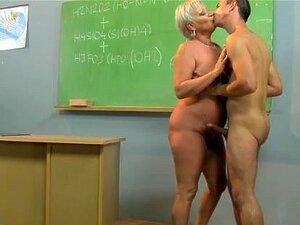 Horny GILF teacher bouncing on students dick