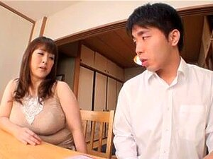 Japanese Mature titty fucks a dude,