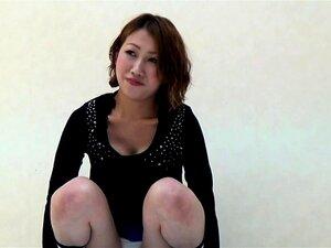 Asian urinates into box