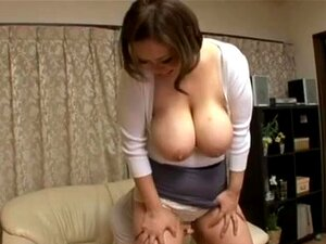 Reiko Yumeno Japanese hottie shows off her big tits.