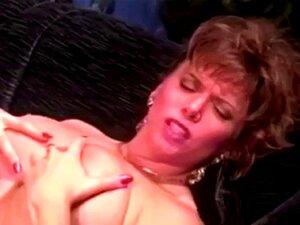 Retro erotic massage. Vintage babe massaging her man gently talking on the phone